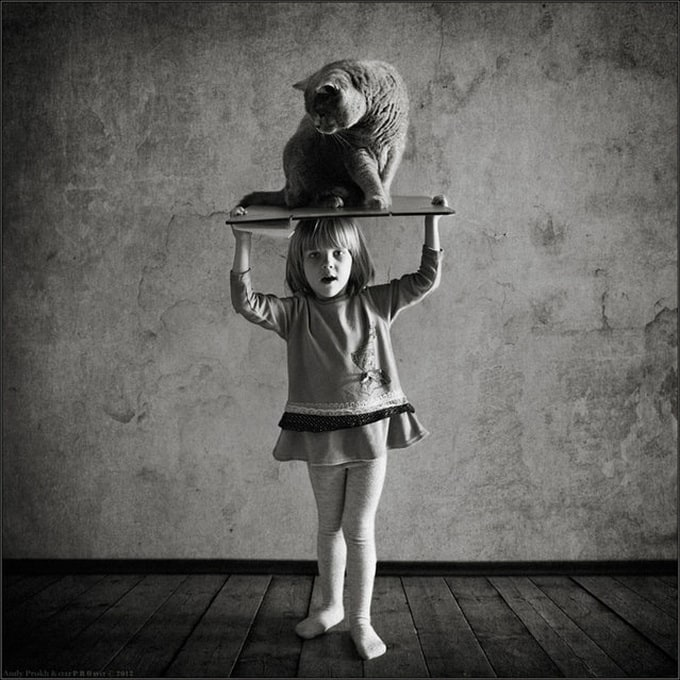 Little Girl and the Cat -cats