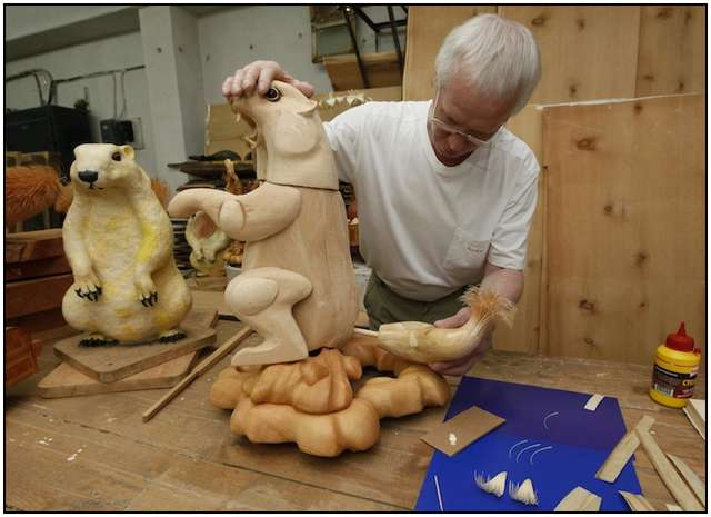 Artist Sergei Bobkov, 55, creates a life-sized sculpture of an Asian marmot made of cut chips at a workshop in a cellar of a local school in Kozhany