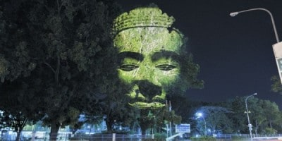 Giant Heads Projected on Trees by Clément Briend