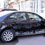 Azerbaijani Parking Attendant Draws Urban Landscapes on Dusty Cars