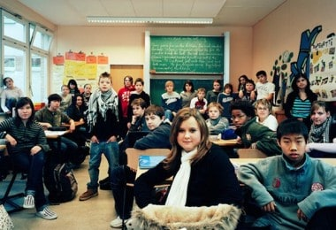 Classes of School Kids from all over the World in their Classrooms