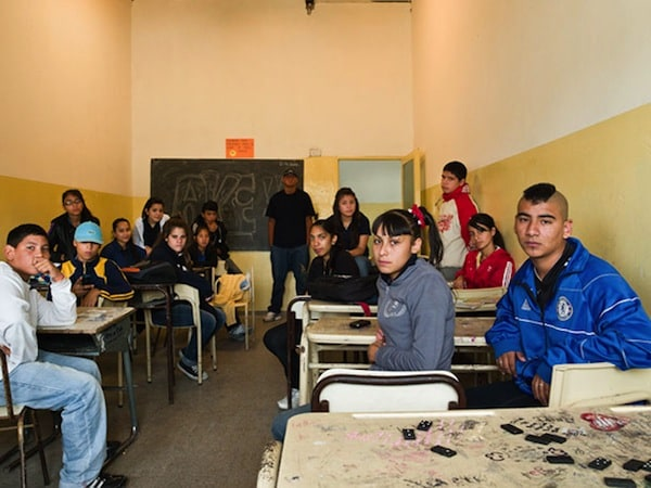 Classes of School Kids from all over the World in their Classrooms -