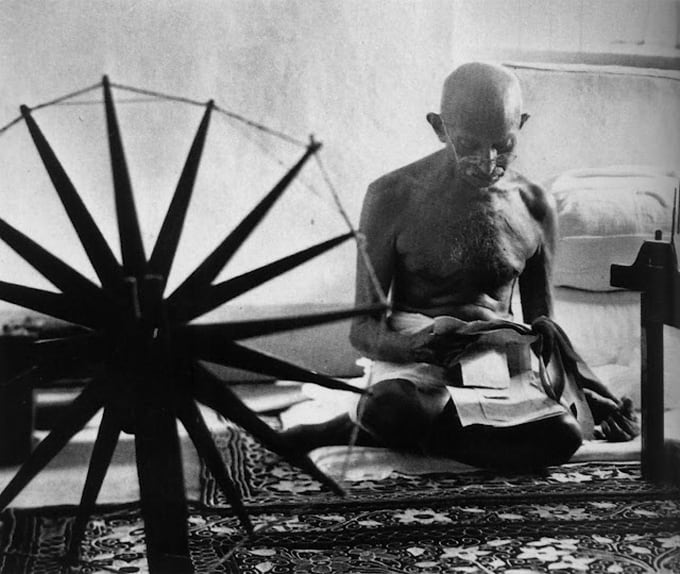Mahatma Gandhi near his distaff, 1946