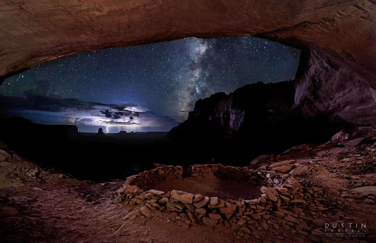 A Perfect Storm captured from the giant window of the False Kiva in Canyonlands, Utah