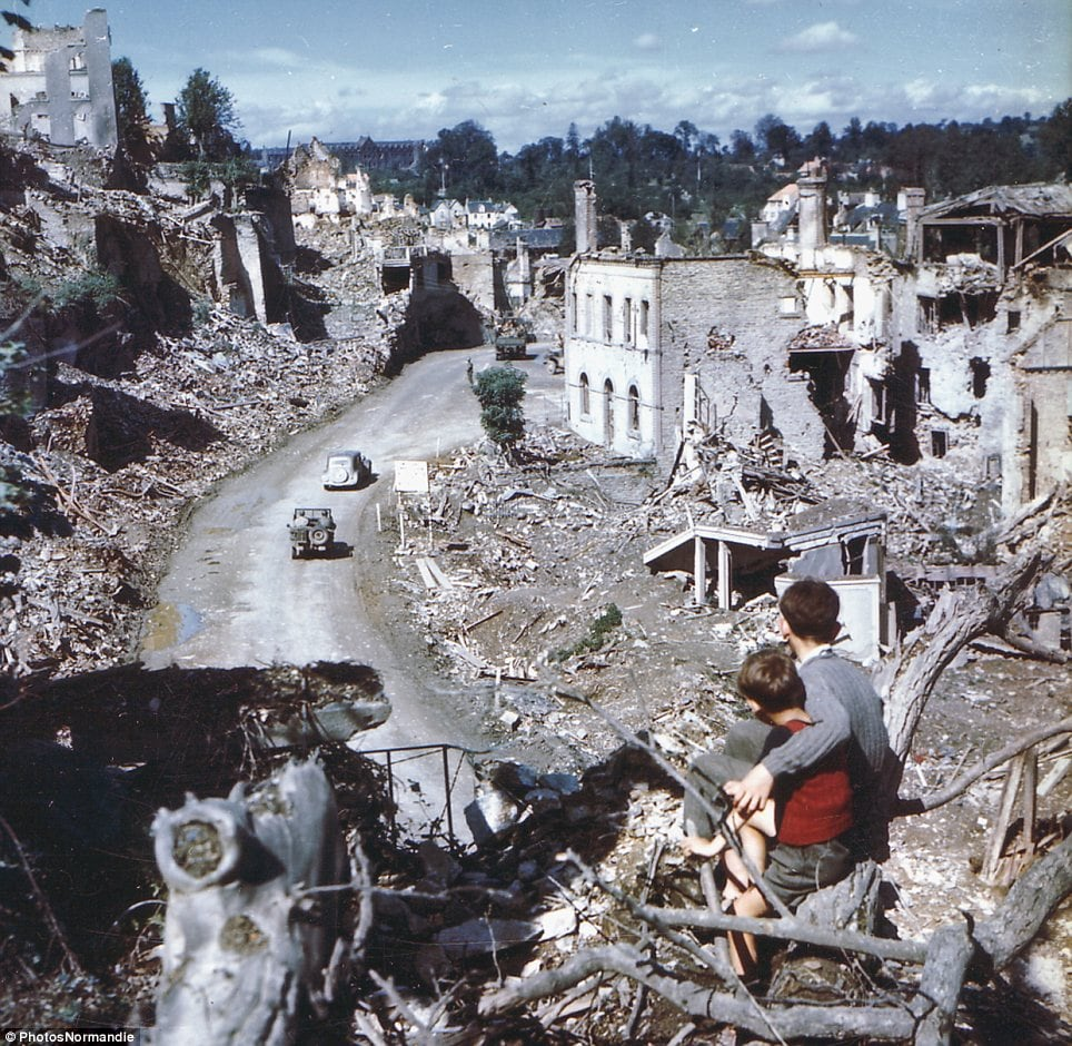 In the aftermath of the D-Day invasion, two boys watch from a tree as American soldiers drive through the town of St. Lo. France