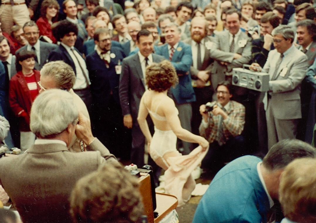 A stripper visits the trading floor of the Toronto Stock Exchange, late 1970s