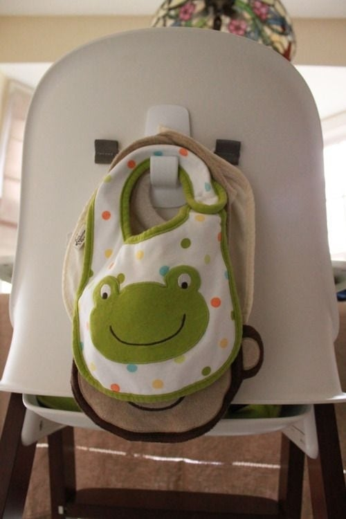 Use a command hook behind your high chair to hang bibs.