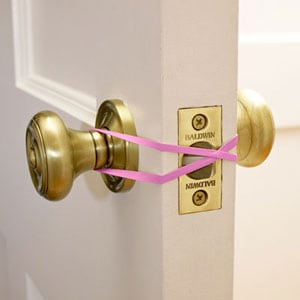 Use a rubberband if you want to keep your door open. (For example, when you're carrying groceries.)