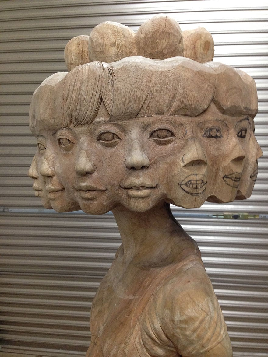 Wood-Sculptures-Of-Bizarrely-Twisted-Characters-By-A-Surreal-Japanese-Artist-8