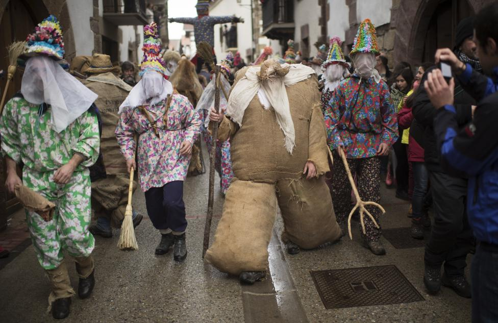 Ziripot, a traditional figure stuffed with straw, takes part in carnival celebrations in Lantz