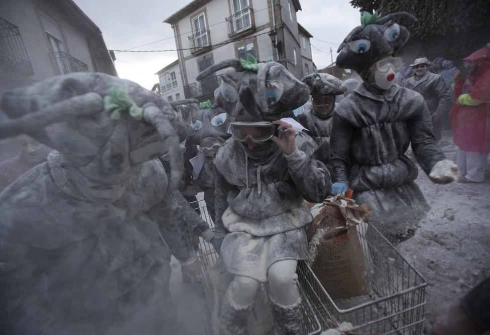 "Revellers participate in a flour fight during the ""O Entroido"" festival in Spain's northwestern village of Laza"
