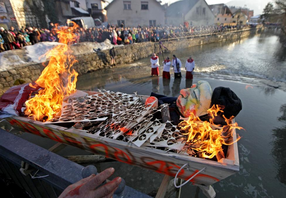 People burn the Pust effigy at the end of the Pust carnival in Cerknica