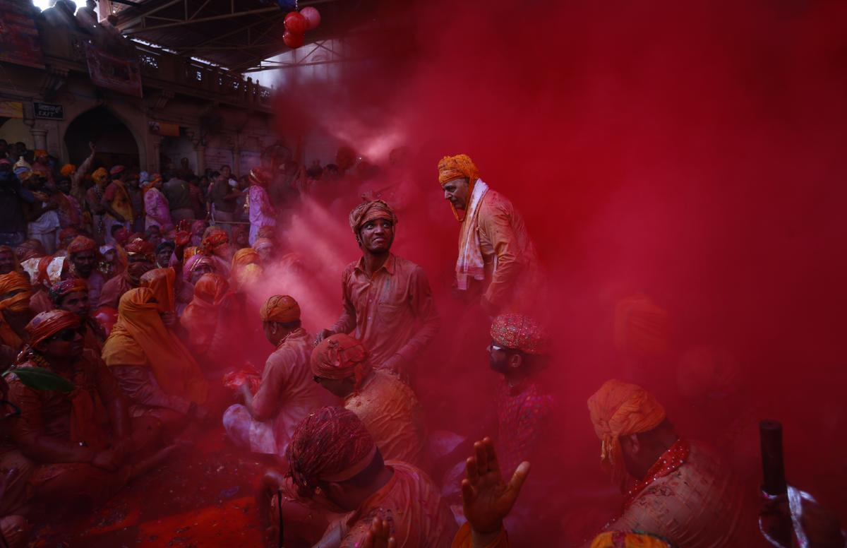 Hindu men from the village of Nandgaon threw colored powder at each other before joining a procession for the Lathmar Holi festival at the legendary hometown of Radha, consort of Hindu God Krishna, in Barsana, India, on Feb 27. (Saurabh Das/Associated Press)