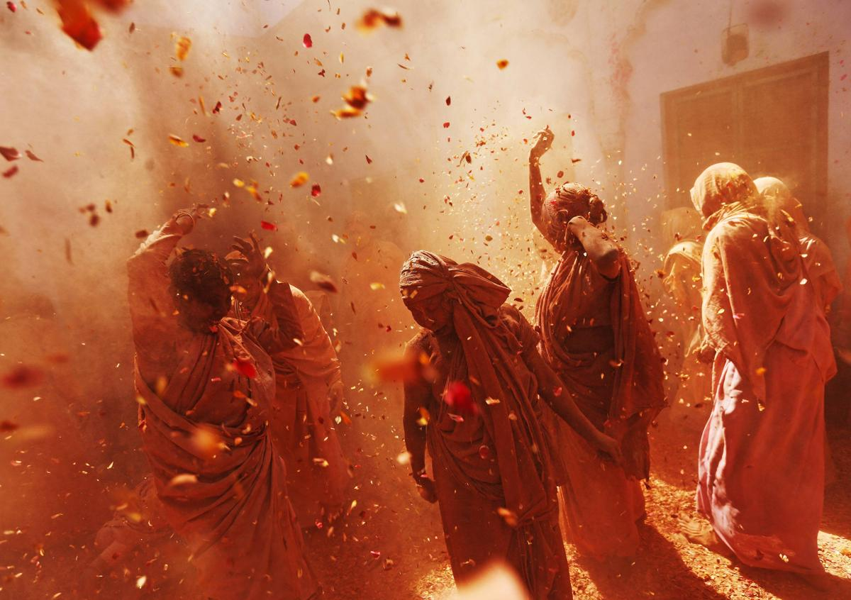 Widows daubed in colors danced as they took part in the Holi celebrations organized by nongovernmental organization Sulabh International in the northern Indian state of Uttar Pradesh on March 6. Traditionally in Hindu culture, widows are expected to renounce earthly pleasure so they do not celebrate Holi. But widows at the shelter, who have been abandoned by their families, celebrated the festival by throwing flowers and colored powder. (Adnan Abidi/Reuters)