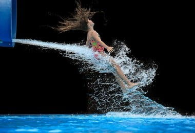 10 Perfectly Timed Photos Of People Shooting Out Of Waterslides 9