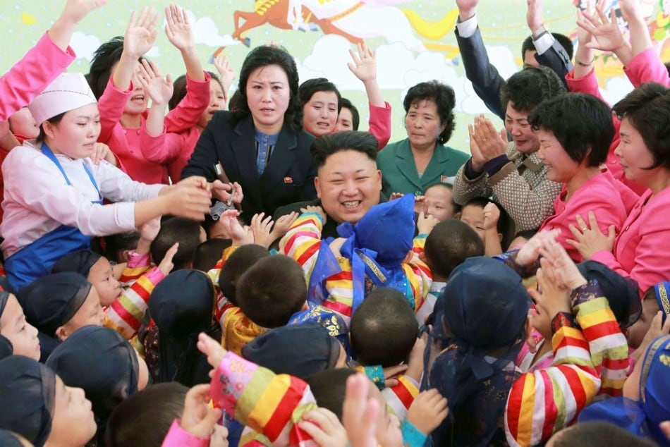 North Korean leader Kim Jong Un (C) poses for a picture with children during a visit to the Pyongyang Baby Home and Orphanage on New Year's Day in this photo released by North Korea's Korean Central News Agency (KCNA) in Pyongyang January 2, 2015. (Photo by Reuters/KCNA)