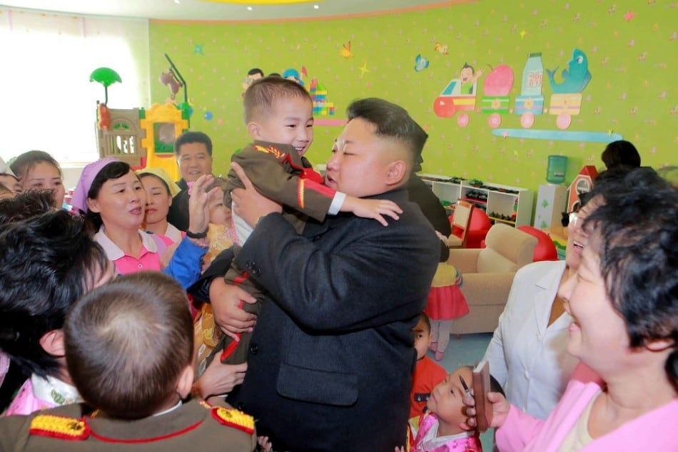 North Korean leader Kim Jong Un (L) visits the Pyongyang Baby Home and Orphanage on New Year's Day in this photo released by North Korea's Korean Central News Agency (KCNA) in Pyongyang January 2, 2015. (Photo by Reuters/KCNA)