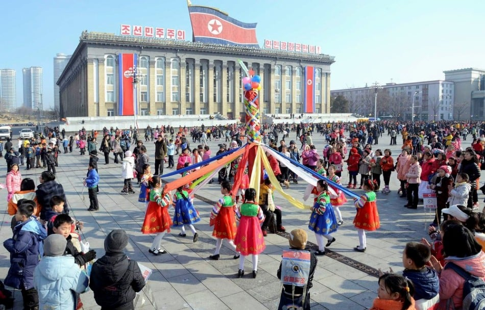 North Koreans celebrate Lunar New Year in this February 19, 2015 photo released by North Korea's Korean Central News Agency (KCNA) in Pyongyang February 19, 2015. (Photo by Reuters/KCNA)