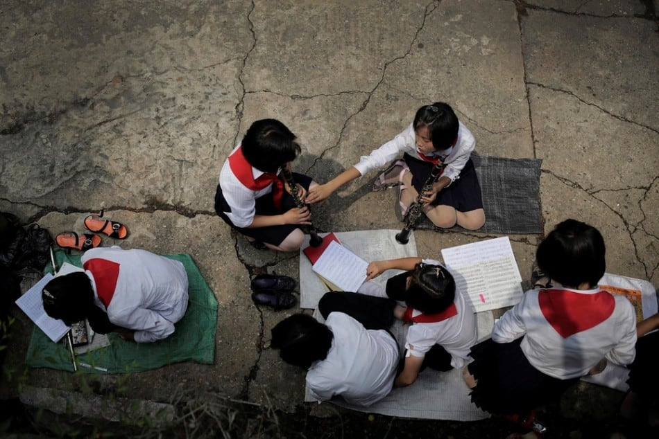 North Korean students practice playing their musical instruments at the Moranbong or Moran Hill, Thursday, July 31, 2014 in Pyongyang, North Korea. (Photo by Wong Maye-E/AP Photo)