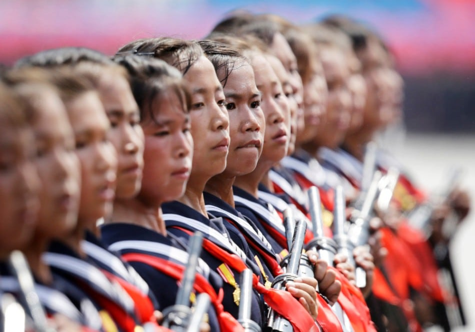 North Korean students carrying guns parade to mark the 60th anniversary of the signing of a truce in the 1950-1953 Korean War at Kim Il-sung Square, in Pyongyang July 27, 2013. (Photo by Jason Lee/Reuters)