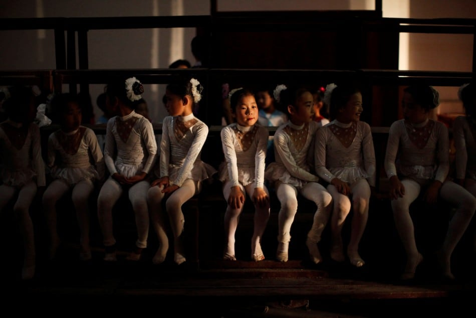 Girls sit backstage before their performance at a local school in Rason city, northeast of Pyongyang, August 29, 2011. (Photo by Carlos Barria/Reuters)