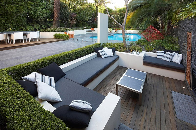 outdoor-Living-with-wooden-floor-tiles-garden-plants-sunken-lounge-views-to-pool-and-surrounding-greenery-ideas