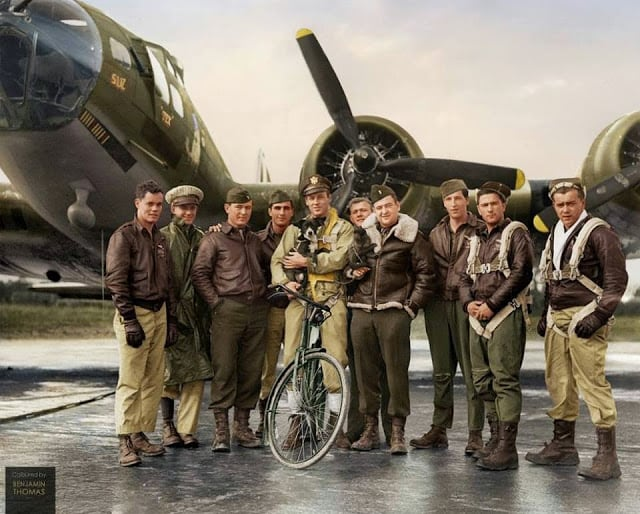 US Air Force pilot 2nd Lieutenant Robert Wade Biesecker with his crew of the 569th Bombardment Squadron, 390th Bomb Group, US Eighth Air Force, standing by 'Honey Chile', their B-17 Flying Fortress bomber (serial 42-31027), at RAF Framlingham, a US Eighth Air Force Bomber Command station in England, 18 October 1943. (Photographer: M. McNeil, for Fox Photos. Images courtesy of the Hulton Archive/ Getty Images. Colorized and researched by Benjamin Thomas from Australia)