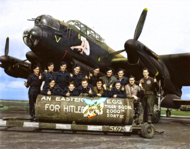 """F/L J. F. Thomas and the crew of Avro Lancaster Bomber 'B' MkI 'Victorious Virgin' RF128 QB-V of RCAF 424 Squadron """"Tiger"""" Squadron on the 21st of March 1945. (probably taken at the Skipton-on-Swale, North Yorkshire airfield). (Colorized by Tom Thounaojam from India)"""