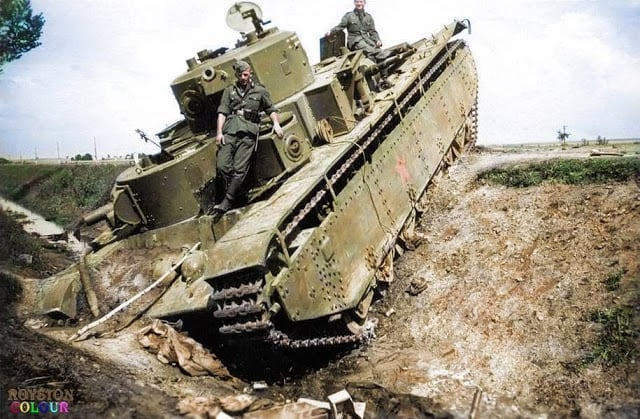 A broken down and deserted Soviet T-35 heavy tank of the 8th Mechanised Corps. On the Dubno - Plycza highway, Rivne Oblast (province) of western Ukraine. June/July 1941. (Colorized by Royston Leonard from the UK)