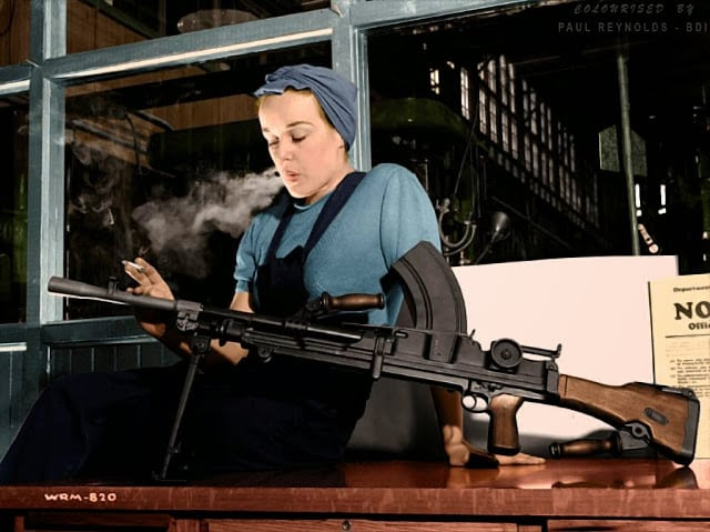 """Veronica Foster, (b.1922 - d.2000) popularly known as """"Ronnie, the Bren Gun Girl"""", was a Canadian icon representing nearly one million Canadian women who worked in the manufacturing plants that produced munitions and materiel during World War II. Colorized by Paul Reynolds. Historic Military Photo Colourisations)"""