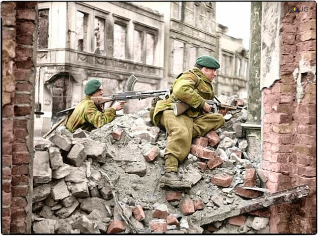 Royal Marines from 45 (RM) Commando, 1st Commando Brigade on the look-out for snipers among the ruins in Osnabrück, Lower Saxony, Germany. 4th of April 1945. (Source - IWM BU 3057. Photographer - Sgt.Laws No 5 Army Film & Photographic Unit. Colorized by Doug)
