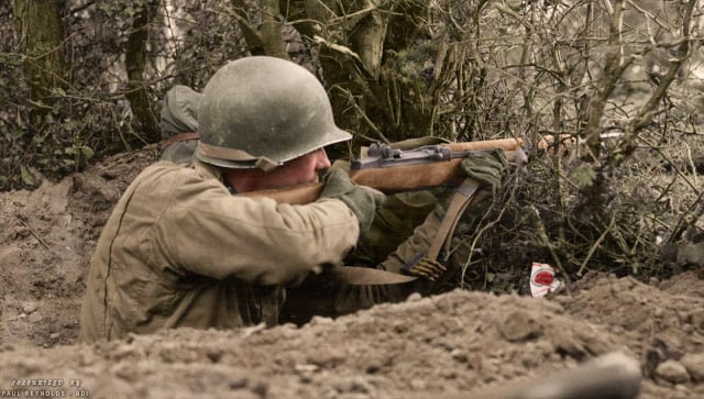 """""""Lucky Strike"""" c. 1944. The United States was the only country to equip its troops with an auto-loading rifle as the standard infantry weapon of WWII. It gave their troops a tremendous advantage in firepower, and led General George Patton to call the M1 Garand, """"The greatest battle implement ever devised."""" (Colorized by Paul Reynolds. Historic Military Photo Colourisations)"""