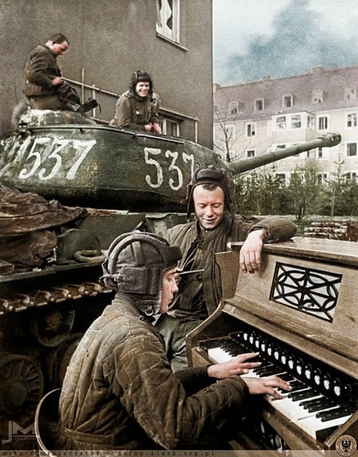Crew members of Nº537 Soviet IS-2 tank of the 87th Guards Heavy Tank Regiment take a break in Breslau (now Wrocław in Poland) 27th April 1945. (Photographer - Anatoli Egorov. Colorized by Jiří Macháček from the Czech republic)