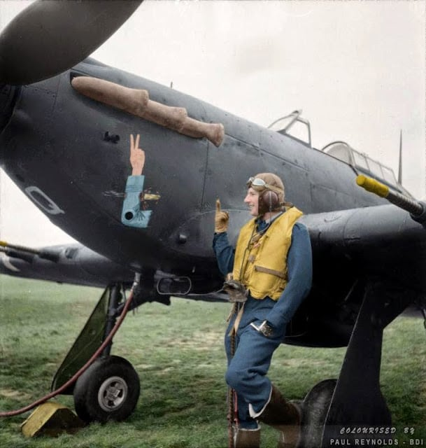 Squadron Leader J.A.F. MacLachlan, the one-armed Commanding Officer of No 1 Squadron RAF, standing beside his all-black Hawker Hurricane Mark IIC night fighter, 'JX-Q', at Tangmere in West Sussex, England. (Source - Royal Air Force official photographer Woodbine G (Mr) © IWM CH 4015. Colorized by Paul Reynolds. Historic Military Photo Colourisations)
