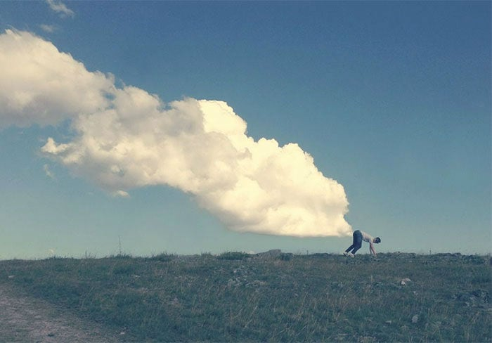 18 Playful Photos Of People Playing With Clouds -clouds