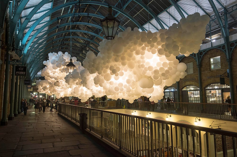 A Suspended Cloud of 100,000 Illuminated Balloons Hanging Inside Covent Garden by Charles Pétillion -london, installation, balloons