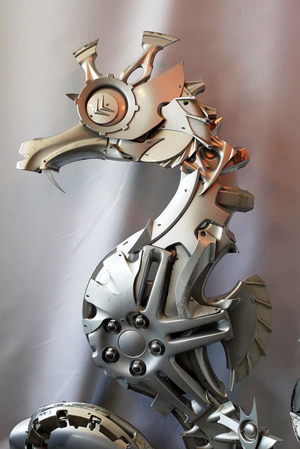 hubcap sculpture seahorse - The Artist Turns Useless Hubcaps Into Impressive Looking Sculptures