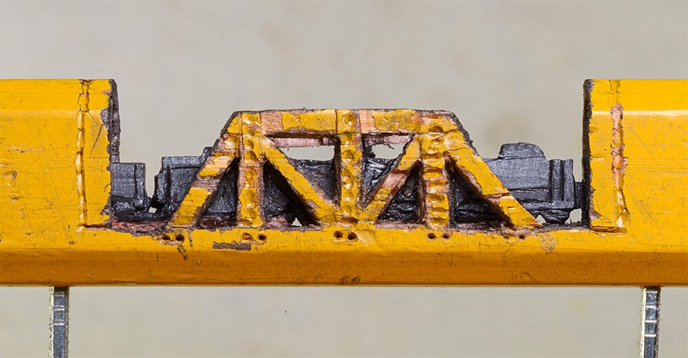 A Tiny Graphite Train on Tracks Emerges from Inside a Pencil -sculpture, miniature, carving