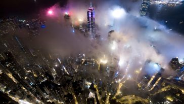 Striking Bird's-Eye View Hong Kong Wrapped in Fog by Andy Yeung -Hong Kong, fog, clouds, aerial