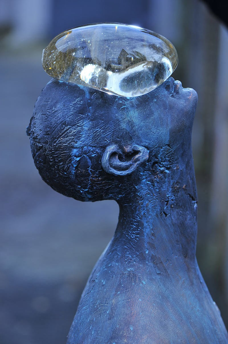 Giant Glass Raindrop Rests on Man's Face in Ukraine -statue, sculpture