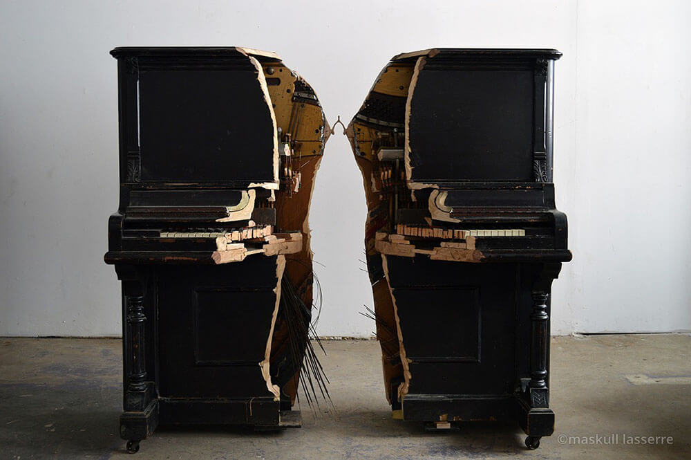 Artist Connected Two Parts of Piano With a Wishbone -wood, sculpture, carving, anatomy