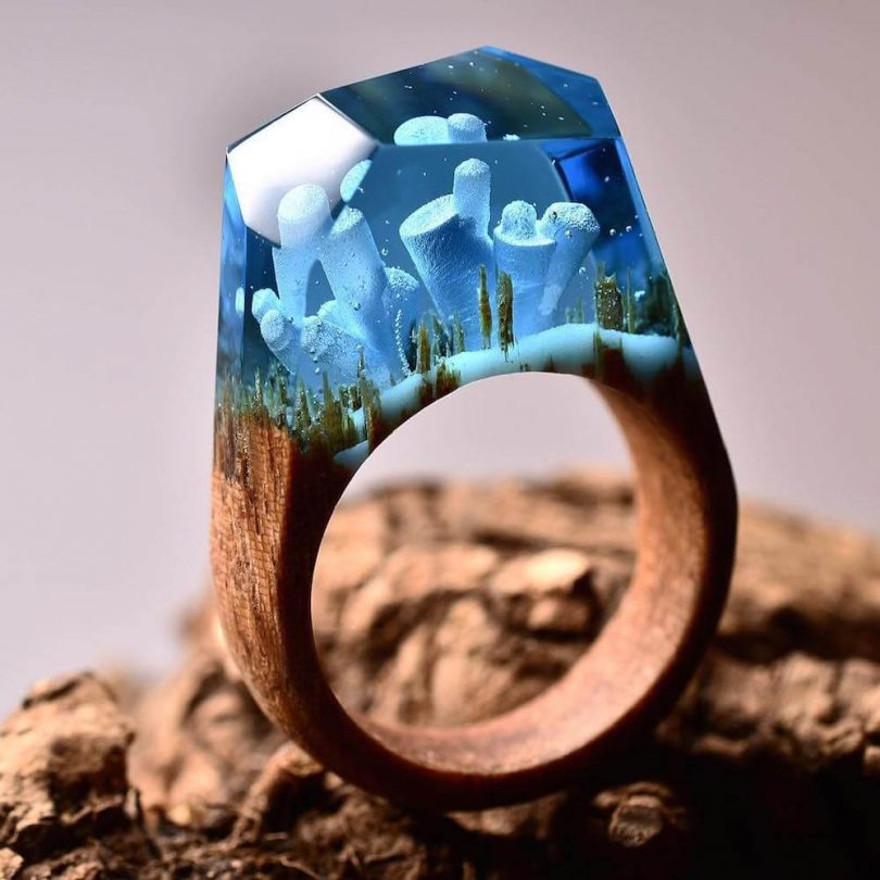 Ethereal Worlds Enclosed In Wood And Resin Rings