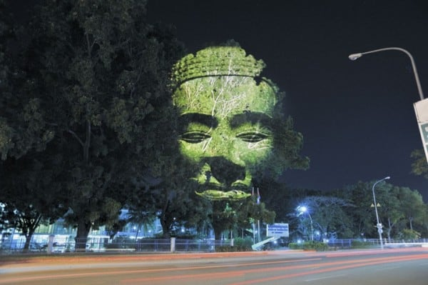 Giant Heads Projected on Trees by Clément Briend -tree, project