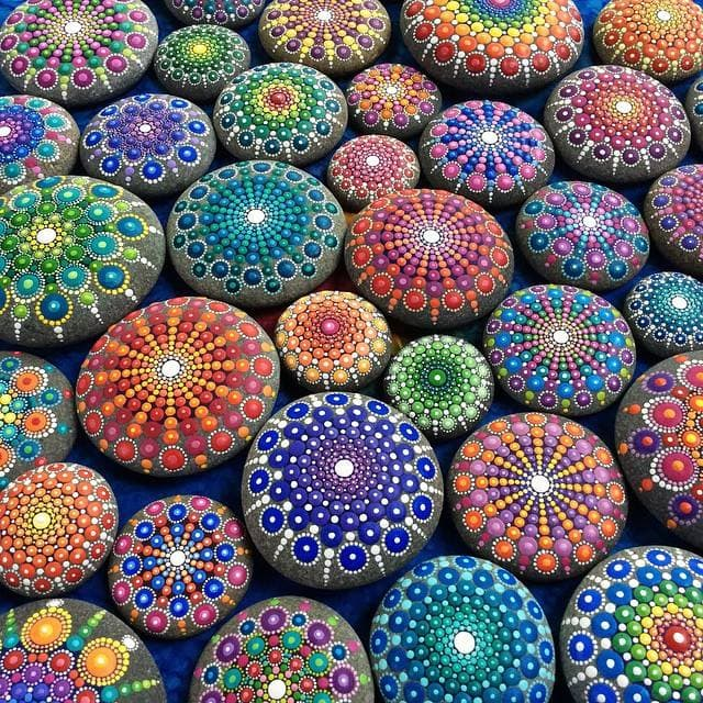 Artist Creates Dazzling Ocean Stones Covered in Colorful Tiny Dots -artist, amazing