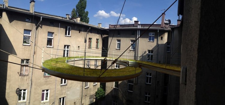 Spiraling Green-Covered Walkway Suspended High Above the Central Courtyard of a Building -poland