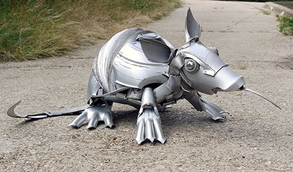 hubcap sculpture armadillo - The Artist Turns Useless Hubcaps Into Impressive Looking Sculptures