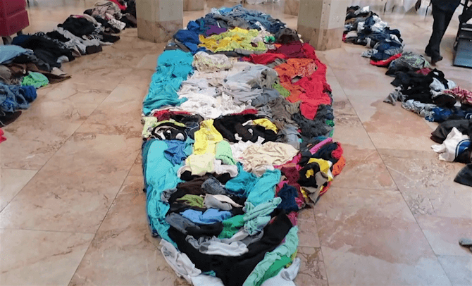 Huge Anamorphic Portrait Created From Donated Clothing -portrait, museum, installation, exhibition