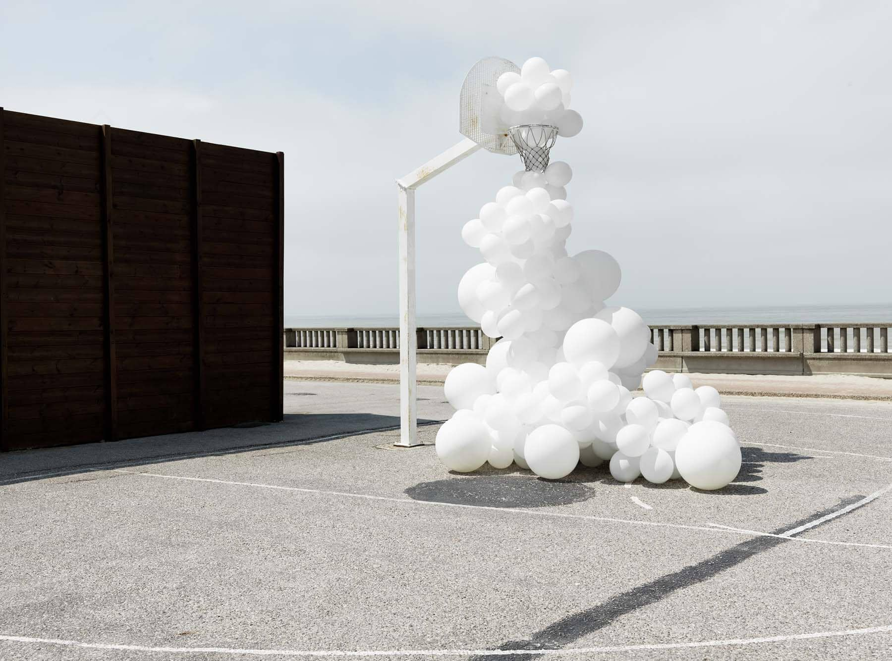 Clumps of Balloons Photographed Invading Landscapes by Charles Pétillon -multiples, installation, balloons