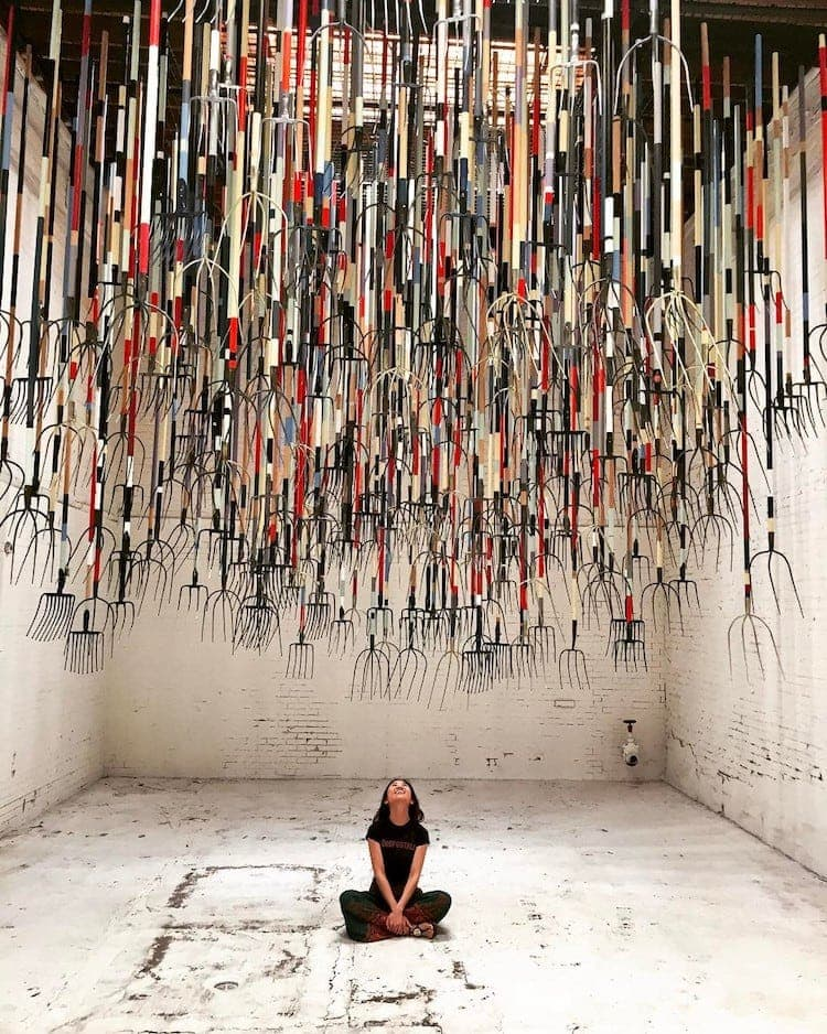 pitchfork installation simon birch 10 - Artist Dares Visitors to Stand Under Pointy Pitchforks Swinging from the Ceiling