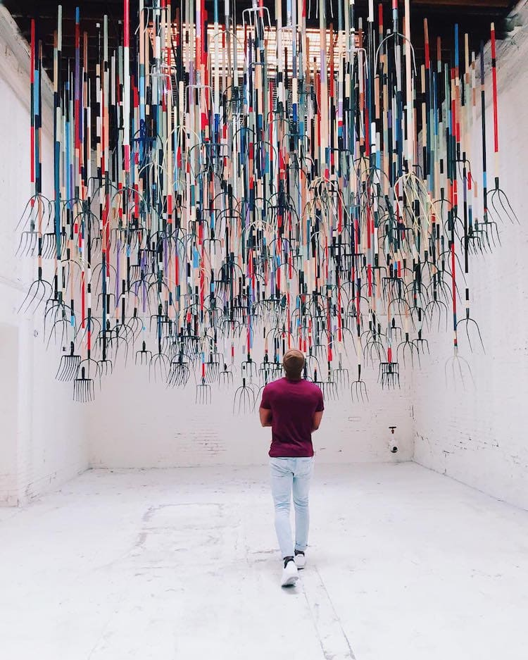 pitchfork installation simon birch 2 - Artist Dares Visitors to Stand Under Pointy Pitchforks Swinging from the Ceiling